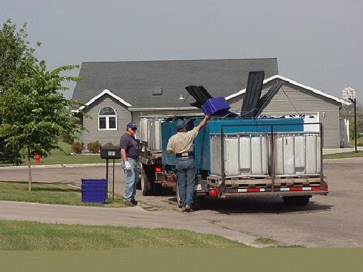 Men Picking up Curbside Recycling