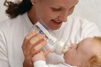 Woman Feeding Baby with Bottle