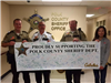 Officers Holding a Cabela's Employees Signed Poster