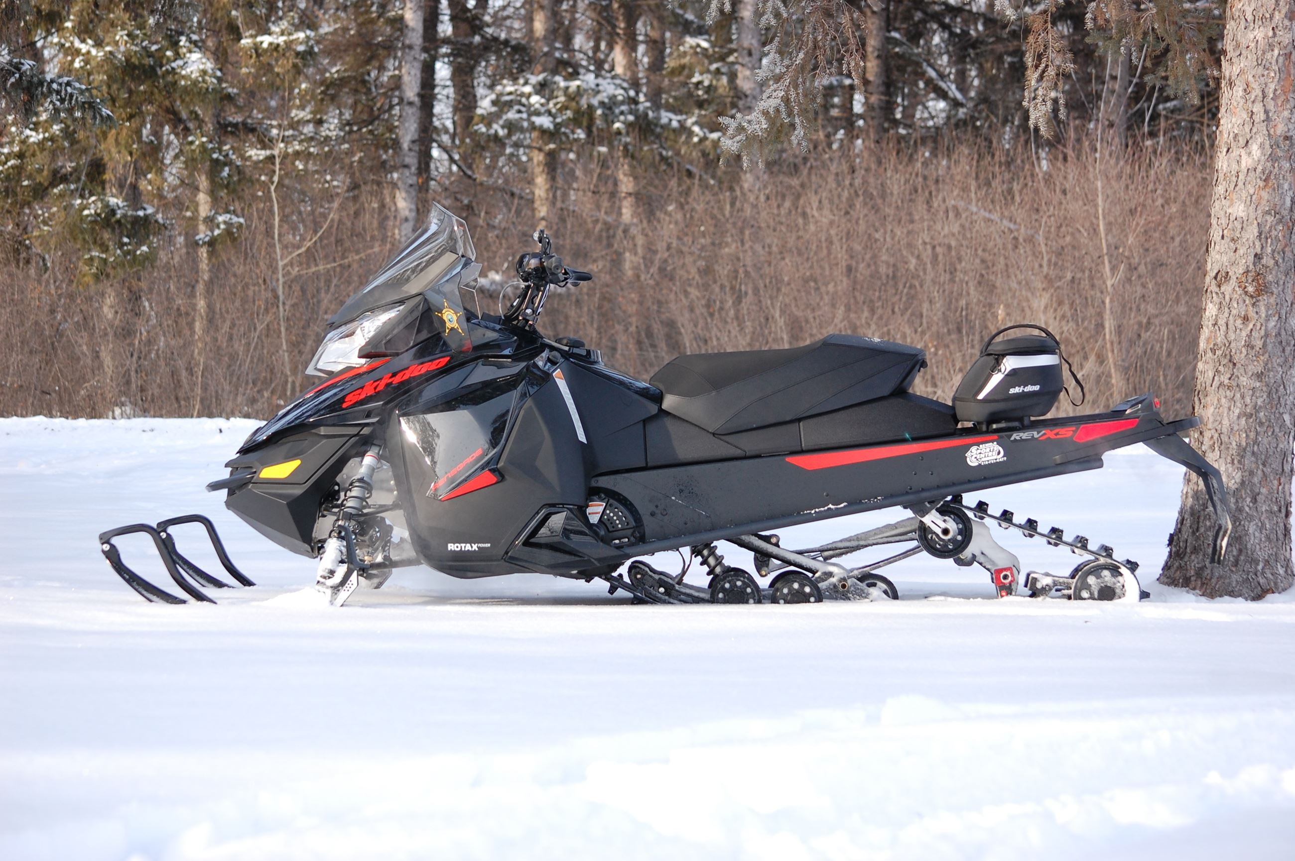 A Black Snowmobile on the Snow
